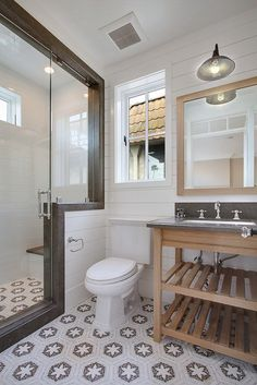 bathroom, barn light, tiles, shower enclosure, sink vanity under storage