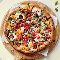 Caprese Pizza | Cooking Light.  Tips for dough: Let sit at room temp 30 min before rolling out, stab with fork all over to keep from puffing, and pre-bake to avoid soggy pizza.