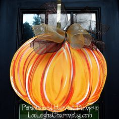 Door Hanger: Fall Pumpkin, Fall Home Decor, Pumpkin Door Decoration, Thanksgiving Decor. $42.00, via Etsy.