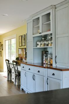How beautiful is that blue cabinet? A farmhouse remodel with brand new built-ins made to look original to the home.