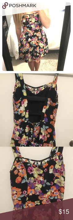 Floral Skater Dress Colorful floral pattern with adorable back detail! Slightly worn Material Girl Dresses Mini