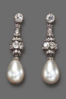 A PAIR OF ART DECO DIAMOND AND NATURAL PEARL EAR PENDANTS, CIRCA 1925. The drop-shaped pearl suspended by a rose-cut diamond cap, from three old European-cut diamond rondelles, to the sculpted single and old European-cut diamond fancy-link and diamond collet surmount, mounted in platinum. #ArtDeco #earrings