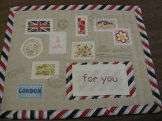 Airmail mug rug with London themed stamps and much more loveliness!  Handmade by earthtonesgirl.com