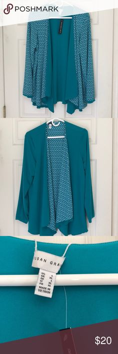 Susan Graver Reversible Liquid Knit Cardigan Susan Graver Liquid Knit Cardigan you'll get two distinct looks from one piece with a solid color side and printed side.  The cardigans open front drapes in complementary fashion. Susan Graver Other