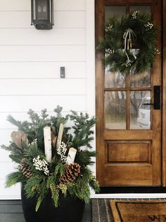 36 Amazing Summer Planters Ideas For Your Front Door Decor - he front door of your house is one of the very first things that people see when they come to visit you. It is one of the most important aspects when . Christmas Planters, Christmas Porch, Farmhouse Christmas Decor, Noel Christmas, Outdoor Christmas Decorations, Holiday Decor, Xmas, Christmas Greenery, Front Porch Flowers