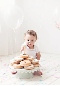 And adorable doughnut smashing party with confetti for a first birthday! The perfect family shoot idea! https://www.theprettyblog.com/family/fun-filled-first-birthday-celebration/?utm_campaign=coschedule&utm_source=pinterest&utm_medium=The%20Pretty%20Blog&utm_content=Fun-Filled%20First%20Birthday%20Celebration
