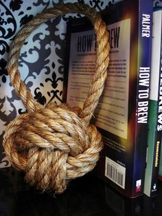 Heart Maine Home: Rope knot bookend {DIY}. (This is my sister's blog. She's incredibly talented! Check out all the other crafty things she's done)