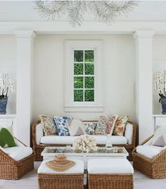 Love the pillows and the white furniture... Looks so relaxing