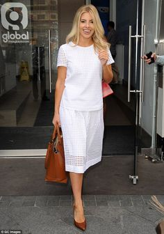 Demure: Mollie King wore an understated white top and matching broderie midi-skirt. Short Celebrities, Mollie King, King Fashion, Cut Off, White Tops, Midi Skirt, Celebrity Style, Denim Shorts, White Dress