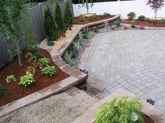 Unilock Paver Patio, Keystone Retaining Walls & Stairs, Cobblestone Border & Aluminum Edging Designed & Installed by Done Rig... | Yelp