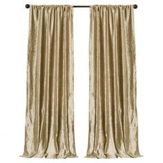 """Faux velvet curtain in gold.   Product: Set of 2 curtainsConstruction Material: 100% PolyesterColor: GoldFeatures:  No lining3"""" Rod pocket Dimensions: 84"""" H x 40"""" W eachCleaning and Care: Dry clean"""
