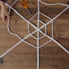 Get spooky this season with an adorable giant braided spiderweb. Perfect for indoor or outdoor decorating, this festive Halloween craft is easy and budget-friendly. decorations outdoor Make a Giant Braided Spiderweb - Halloween Decor DIY Halloween Prop, Halloween Festival, Holidays Halloween, Halloween Crafts, Holiday Crafts, Halloween Recipe, Women Halloween, Halloween Nails, Halloween Makeup