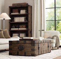 RH's Heirloom Silver-Chest Coffee Trunk:Drawing inspiration from an heirloom silver trunk, our authentic reproduction has been repurposed for use as a coffee table. Hand-crafted of solid hardwood, it is accented with substantial hand-forged, hand-hammered iron hardware.