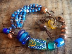 yuccabloom's Jasper, Agate, African Beads and Copper Beaded Leather Charm Bracelet. LOVE the beads & color combo
