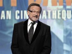Official: Robin Williams hanged himself with Belt