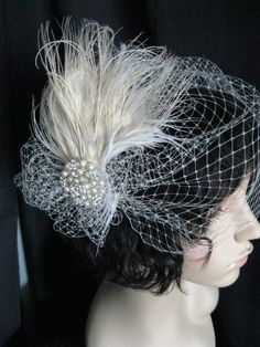 Birdcage veil with some sort of brooch in the middle