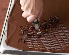 Use a Zester for Chocolate Curls – Article – FineCooking Chocolate Curls – Use a large offset spatula to spread melted chocolate evenly over the back of a rimmed baking sheet to create a. Chocolate Work, Chocolate Curls, Melting Chocolate, Chocolate Cream, Chocolate Ganache, Cake Decorating Techniques, Cake Decorating Tips, Cookie Decorating, Diy Dessert