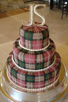 Plaid cake in Nancy Drew colors with magnifying glass, notebook, fingerprints, etc. placed on layers