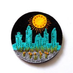 CITYSCAPE FELT BROOCH  MEASUREMENT 7cm.  MATERIALS Felt Embroidery cotton  Please do not hesitate to contact me if you require any further information.