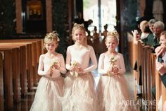 Darling flower girls carried champagne roses