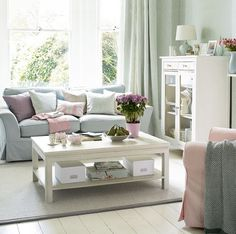 PrettifulColour Scheme for front room.. light blue sofa, light wooden floor with white/cream tv unit and natural rug. Light pinks and purples with mint walls?