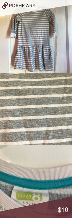Kids Dress This is a kids dress from Crazy 8! It is a gray and white striped dress. It also has pockets, one on each side,with blue thread around them. Taking offers! Crazy 8 Dresses Casual