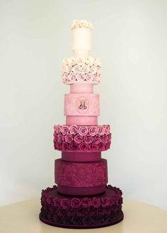 Gorgeous ombré wedding cake ! Prefect for a magenta/maroon theme.