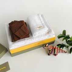 A cute baby boy gift set featuring our rattle soft knit dino. * 4-layer 100% cotton muslin breathable blanket set in White with a matching white lace trim. Measures large 130x130cm/ Small 60x50cm. * Zipped romper with integrated scratch mitts and zip guard in Rust. * Multi stripe soft knit dino with built in rattle. * All orders arrive beautifully gift wrapped in our Deluxe gift box (35x25x10cm). Re-use as a keepsake box. Muslin Blanket Set 4 layers of 100% cotton muslin, pre-washed for ultimate