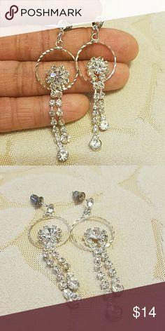 Silver Swavoski Crystal Earrings New. Never worn.  Light weight. Very cute. Measures 5 1/2cm long. Hoop is 1 1/2 cm wide. Jewelry Earrings