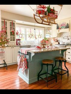 Favorite Beautiful Christmas Decorating Ideas Love this festive Christmas kitchen complete with sleigh holding gifts Christmas Home, Christmas Holidays, Christmas Goodies, Christmas Kitchen Decorations, Cottage Christmas Decorating, Christmas Decir, Christmas Wreaths For Windows, Farmhouse Christmas Kitchen, Christmas Cards