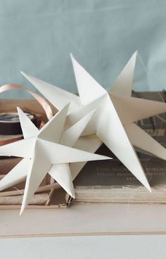 star: Need 2 sheets of paper, scissors, glue, and a pencil. Take sheets of paper and fold into quarters & make sharp edges. Cut the corners & fold inward. Do same to sheet & glue the two together Noel Christmas, Christmas Projects, All Things Christmas, Winter Christmas, Holiday Crafts, Xmas, Christmas Ornaments, Paper Crafts, Diy Crafts