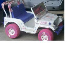 90s Barbie/Power Wheels - Beach Buggy Jeep - had the gray gas pedal, the canopy over the back, a small storage compartment with pull down door for its trunk, pink windshield wipers, fake radio and pink phone or walkie attached