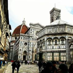 Baptistery of San Giovanni, Florence, Italy, also known as John the Baptist Church, and the Church of Santa Maria del Fiore across the Piazza San Giovanni relative, adjacent to the Giotto's Bell Tower, the architectural style and Giotto's Bell Tower, Notre Dame church slightly similar.