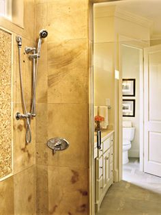 Love the taupe tile and pattern inside the shower.