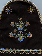 Embroidered Métis panel bag, used for carrying personal medicines, tobacco, and flint and steel for making fire. From the Royal Ontario Museum