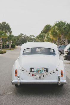 Fun get away car idea - vintage Rolls Royce with just married bunting sign {Woodland Fields Photography}