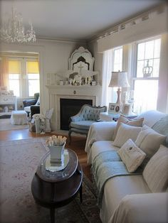.Very nice relaxing room with unique corner fireplace! Neat layered decor on mantle