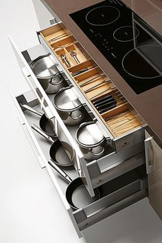 Big drawers like this would be so much better under stove top.