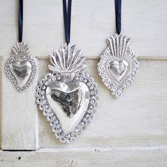 Three Silvered Milagros