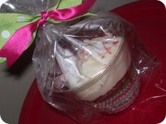 """poor woman's cupcake in a jar""-  It's a frosted cupcake inside a plastic cup then wrapped it up with a treat bag."