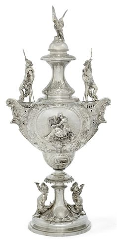 A VICTORIAN SILVER CUP AND COVER - MARK OF HORACE WOODWARD, BIRMINGHAM, 1877, RETAILED BY WEST AND SON.
