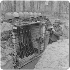 Finnish Soldier stands guard at a makeshift armoury. Please note the different styles of helmets used by the Finnish forces. Eastern Front Ww2, Germany Ww2, Axis Powers, World War I, Wwii, Army, Military, Pictures, Helmets