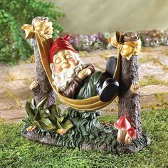 After a long day's labor tending the garden, a rosy-cheeked gnome settles into his favorite hammock to enjoy a well-earned rest. Indoors or out, this fanciful statue adds a witty bit of humor that's sure to warm the heart of any hardworking gardener! Outdoor Garden Statues, Outdoor Gardens, Indoor Outdoor, Outdoor Living, Gnome Garden, Lawn And Garden, Fairies Garden, Garden Oasis, Ideas Dormitorios