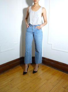 Wide leg cropped light blue denim | https://www.etsy.com/listing/217250144/levis-cropped-wide-leg-jeans-size-28?ref=shop_home_active_8 #tokenmtl #montreal #mtl #vintage #vintagefashion #etsyvintage #vintagelevis #levis #cropped #denim #jeans #blue #wideleg