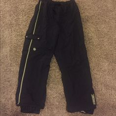 "Ski pants Columbia Black with green strip on side. Used but still lots of life left! I'm 5'7"" and wear a size 6 and they fit perfect. Adjustable waist size. Pocket on side. Columbia Pants"