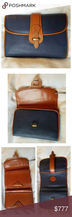 """Vintage Dooney & Bourke AWL Madison Clutch This Vintage D&B All-Weather Leather Madison Clutch in Air Force Blue is a very rare item & it's in pristine vintage condition. Open it is 14"""". Middle snap area: checkbook area & pen holder. (2 slip pockets). The other snap closure area has 5 CC slots, 1 clear ID slot, & 5 slip pockets on one side and 1 notepad w/a slip pocket behind that. There are 3 slip pockets w/the snapped areas closed. 1 exterior slip pocket on the back. From my 🚬🆓🐶🐱🆓🏠…"""