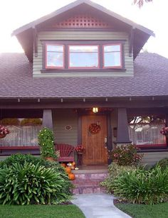 I love craftsman style houses.  All the beautiful wood...it just seems to be so inviting.