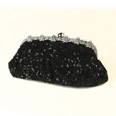 This fabulous black sequined clutch with intricate black beading is an  absolute must have piece  Silver plated floral detailing encrusted with  clear rhinestones truly makes this a unique embellishment and adds a  sparkling touch  Wear this with your perfect evening ensemble to match  and you'll be sure to have the most glamorous accessorySize: 10 Length  6 Height 3 Width