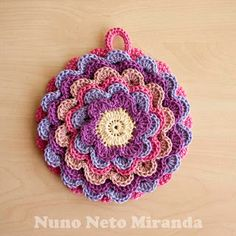 blooming flower, pretty petals potholder-change it a little bit and you have tortilla cover