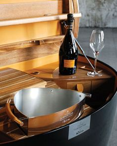 This nautical cruiser trunk / cabin bar houses quite the liquor cabinet full of champagne, dinnerware and accessories. Chest is inspired by classic wooden boat designs. See the details at: http://homebars.barinacraft.com/post/58359173443/veuve-clicquot-champagne-riva-yacht-cruise-collection